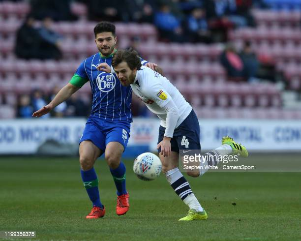 Preston North End's Ben Pearson shields the ball from Wigan Athletic's Sam Morsy during the Sky Bet Championship match between Wigan Athletic and...