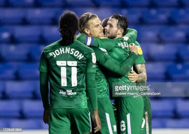 Preston North End's Brad Potts celebrates scoring his side's third goal with his team mates during the Sky Bet Championship match between Reading and...