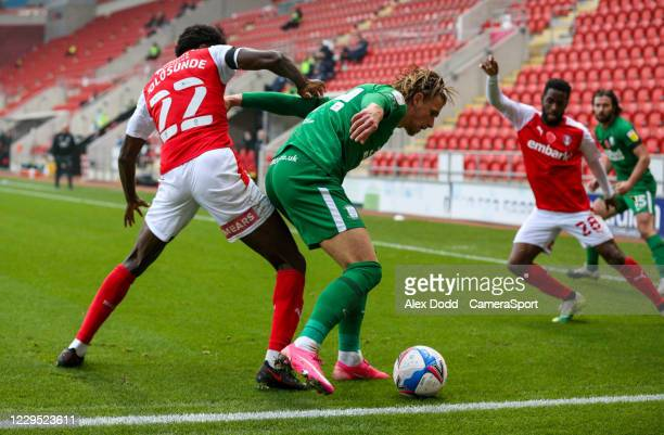 Preston North End's Brad Potts shields the ball from Rotherham United's Matthew Olosunde during the Sky Bet Championship match between Rotherham...