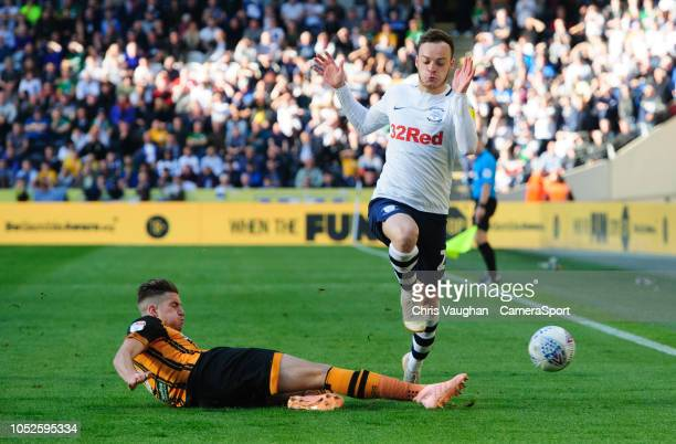 Preston North End's Brandon Barker is tackled by Hull City's Reece Burke during the Sky Bet Championship match between Hull City and Preston North...