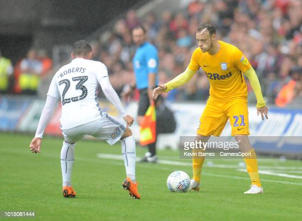 Preston North End's Brandon Barker under pressure from Swansea City's Connor Roberts during the Sky Bet Championship match between Swansea City and...