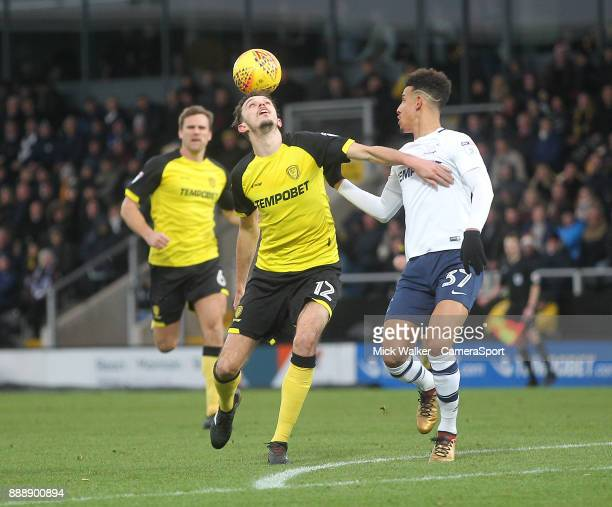 Preston North End's Callum Robinson battles with Burton Albion's Tom Flanagan during the Sky Bet Championship match between Burton Albion and Preston...