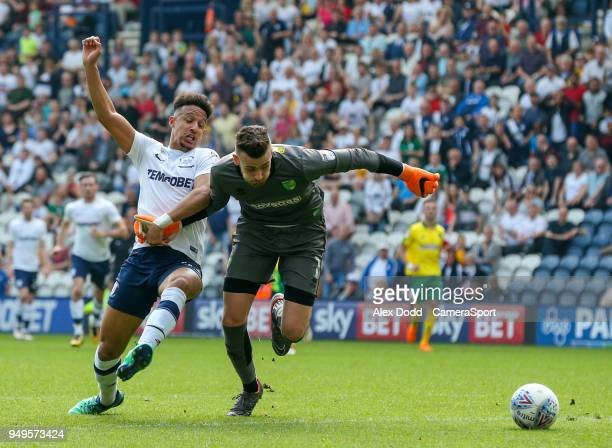 Preston North End's Callum Robinson battles with Norwich City's Angus Gunn during the Sky Bet Championship match between Preston North End and...