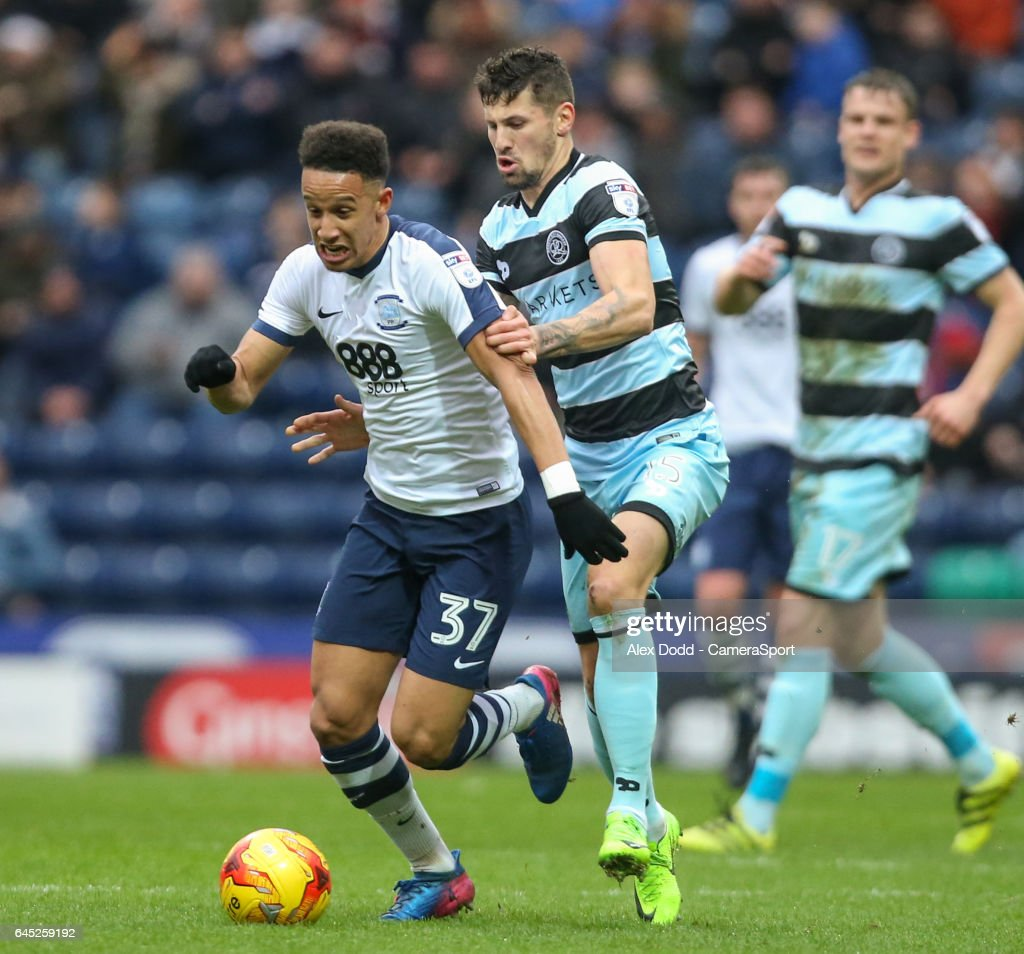 Preston North End's Callum Robinson battles with Queens Park Rangers' Pawel Wszolek during the Sky Bet Championship match between Preston North End and Queens Park Rangers at Deepdale on February 25, 2017 in Preston, England.
