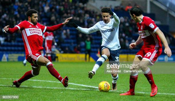 Preston North End's Callum Robinson takes on Middlesbrough's Cyrus Christie and Stewart Downing during the Sky Bet Championship match between Preston...