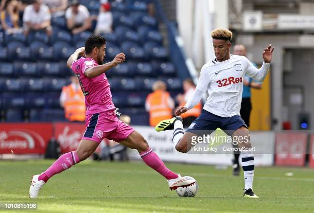 Preston North End's Callum Robinson under pressure from Queens Park Rangers' Massimo Luongo during the Sky Bet Championship match between Preston...