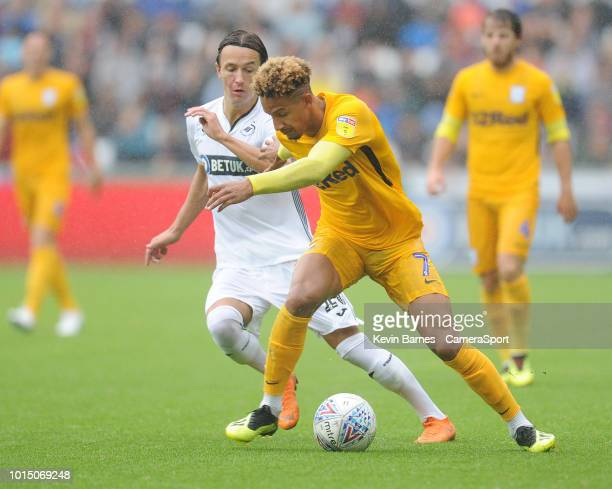 SWANSEA WALES AUGUST Preston North End's Callum Robinson under pressure from Swansea City's Bersant Celina during the Sky Bet Championship match...
