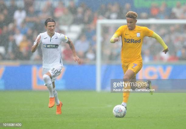 Preston North End's Callum Robinson under pressure from Swansea City's Bersant Celina during the Sky Bet Championship match between Swansea City and...