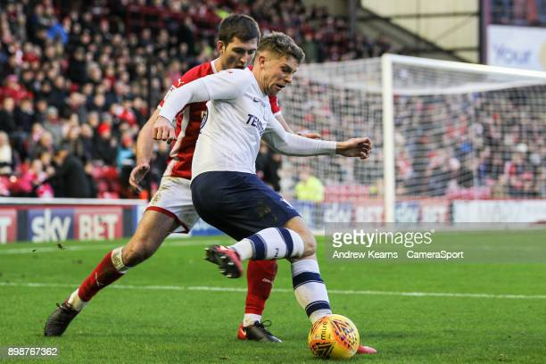 Preston North End's Calum Woods competing with Barnsley's Gary Gardner during the Sky Bet Championship match between Barnsley and Preston North End...