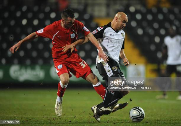Preston North End's Chris Holroyd and Notts County's Gavin Mahon battle for the ball