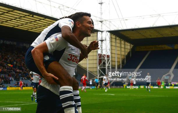 Preston North End's Daniel Johnson celebrates scoring his side's third goal with teammate David Nugent during the Sky Bet Championship match between...