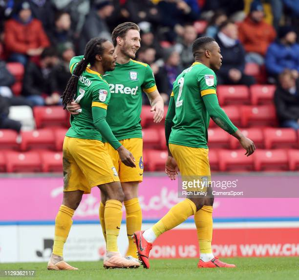 Preston North End's Daniel Johnson celebrates with teammate Ben Davies after scoring the opening goal during the Sky Bet Championship match between...
