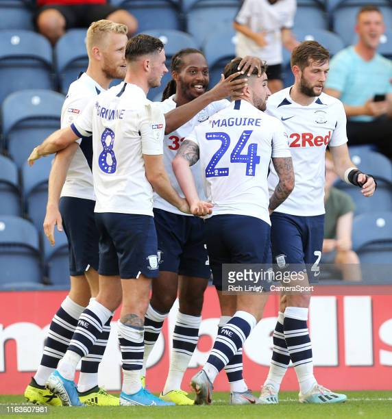 Preston North End's Daniel Johnson celebrates with teammates after scoring his side's second goal from the penalty spot during the Sky Bet...