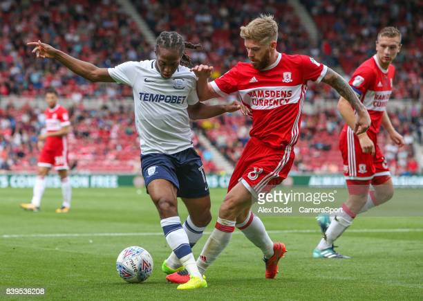 MIDDLESBROUGH ENGLAND AUGUST Preston North End's Daniel Johnson holds off the challenge from Middlesbrough's Adam Clayton during the Sky Bet...