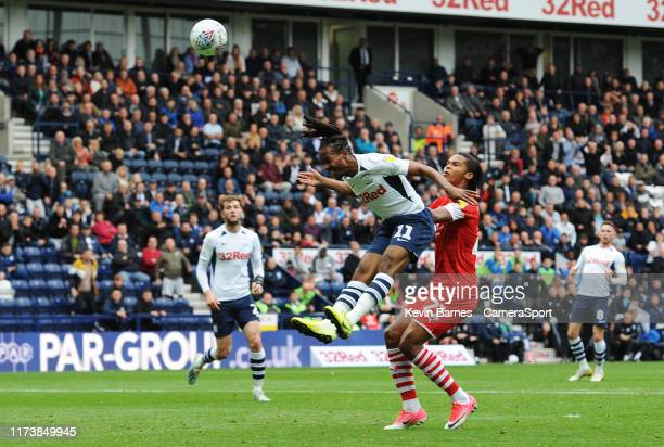 Preston North End's Daniel Johnson scores the opening goal despite the attentions of Barnsley's Toby Sibbick during the Sky Bet Championship match...