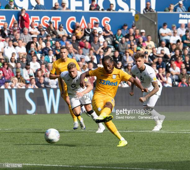 Preston North End's Daniel Johnson takes the penalty to scores his side's second goal during the Sky Bet Championship match between Swansea City and...