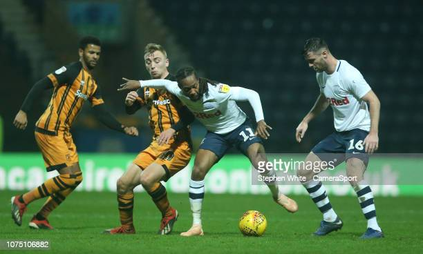 Preston North End's Daniel Johnson watched by with teammate Andrew Hughes shields the ball from Hull City's Jarrod Bowen during the Sky Bet...