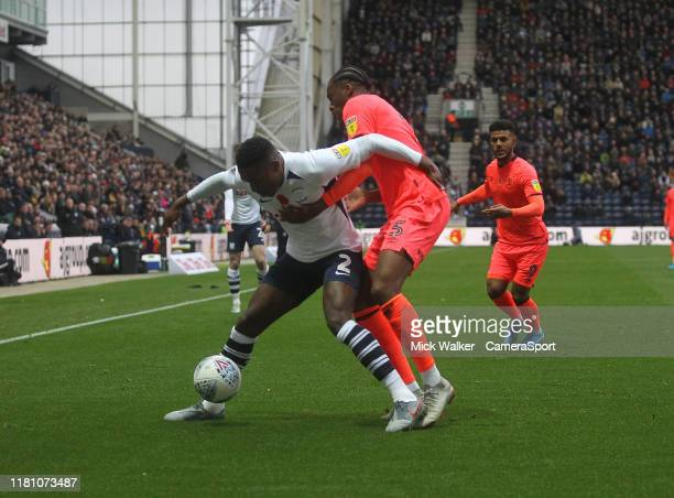 Preston North End's Darnell Fisher battles with Huddersfield Town's Terence Kongolo during the Sky Bet Championship match between Preston North End...
