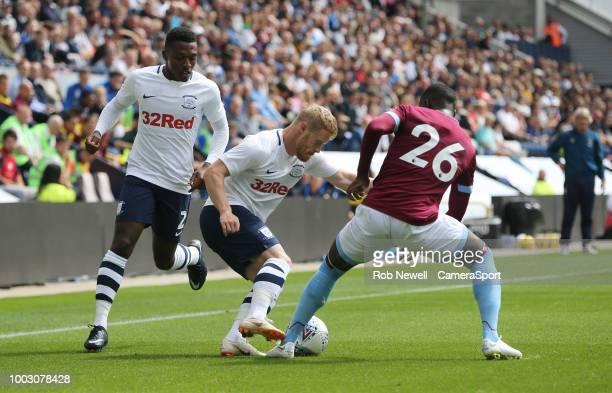 Preston North End's Daryl Horgan and West Ham United's Arthur Masuaku at Deepdale on July 21 2018 in Preston England