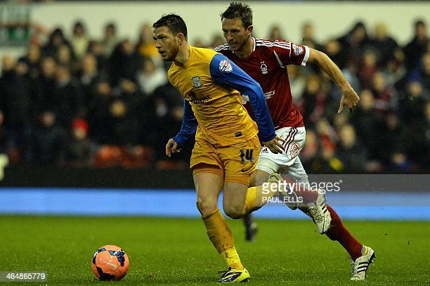 Preston North End's English forward Joe Garner and Nottingham Forest's Welsh defender Danny Collins compete for the ball during the English FA Cup...