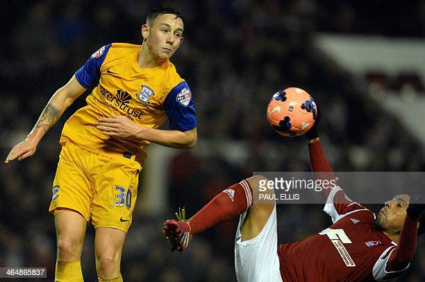 Preston North End's English midfielder Josh Brownhill and Nottingham Forest's Chilean defender Gonzalo Jara compete for the ball during the English...