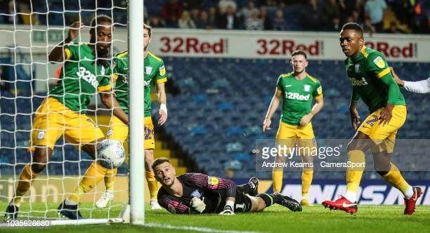 Preston North End's goalkeeper Declan Rudd is beaten by Leeds United's Liam Cooper for their first goal during the Sky Bet Championship match between...