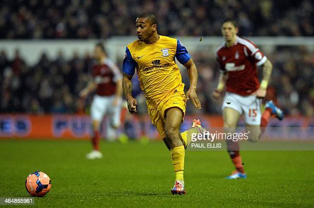 Preston North End's Jamaican midfielder Chris Humphrey runs with the ball during the English FA Cup fourth round match between Nottingham Forest and...