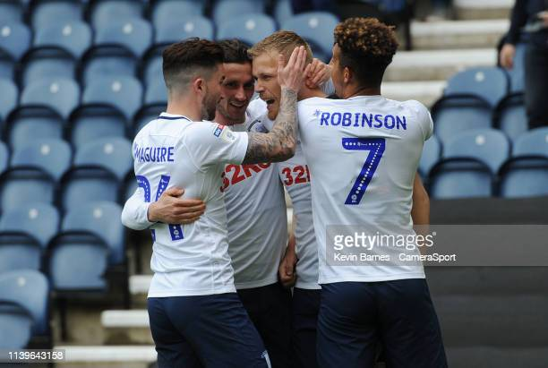 Preston North End's Jayden Stockley celebrates scoring the opening goal with teammates Sean Maguire Alan Browne and Callum Robinson during the Sky...