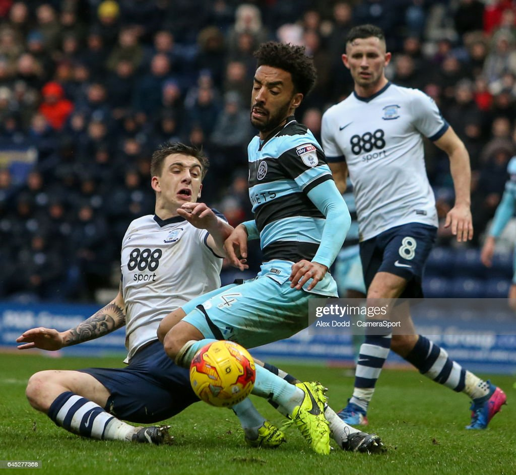 Preston North End's Jordan Hugill battles in the area with Queens Park Rangers' James Perch during the Sky Bet Championship match between Preston North End and Queens Park Rangers at Deepdale on February 25, 2017 in Preston, England.
