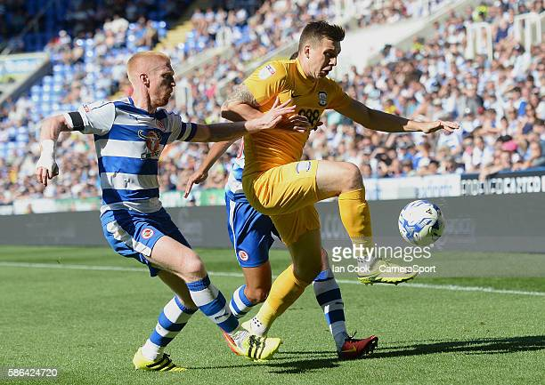 READING ENGLAND Preston North End's Jordan Hugill gets past the challenge of Reading's Paul McShane and Tennai Watson during the EFL Sky Bet...