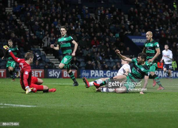 Preston North End's Jordan Hugill scores his sides first goal beating Queens Park Rangers' Alex Smithies during the Sky Bet Championship match...