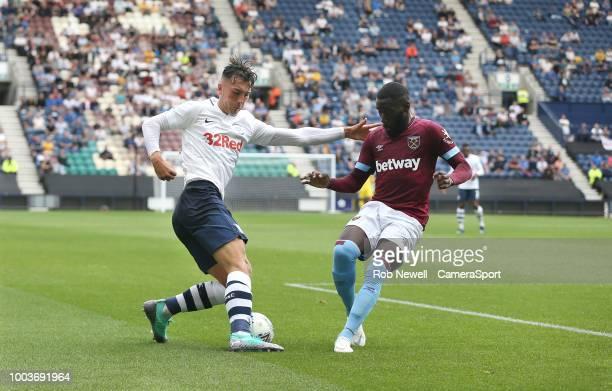Preston North End's Josh Earl and West Ham United's Arthur Masuaku at Deepdale on July 21 2018 in Preston England