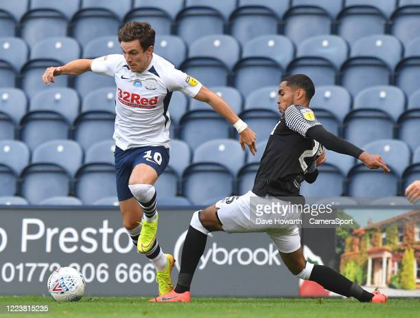 Preston North End's Josh Harrop battles with Derby County's Andre Wisdom during the Sky Bet Championship match between Preston North End and Derby...