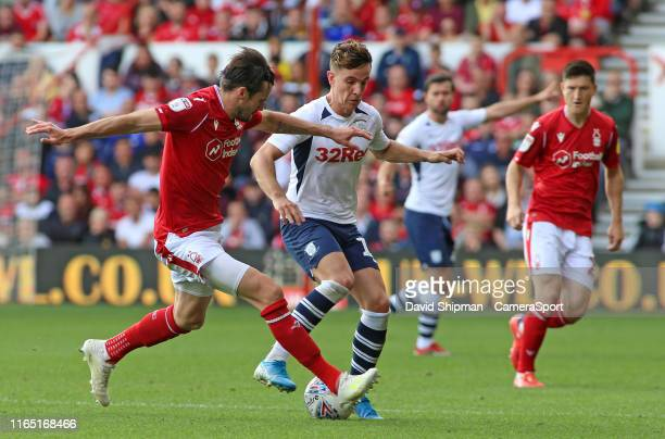 Preston North End's Josh Harrop tries to find a way past Nottingham Forest's Carl Jenkinson during the Sky Bet Championship match between Nottingham...