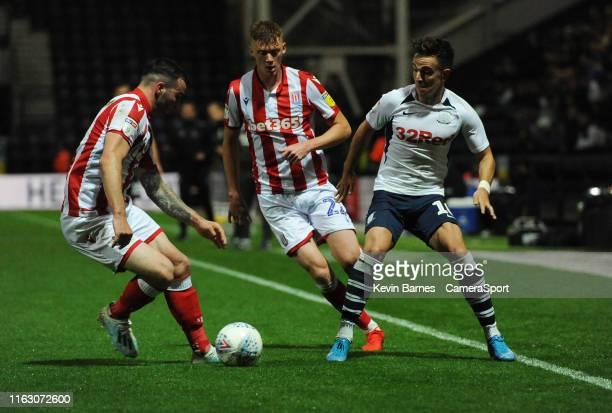 Preston North End's Josh Harrop under pressure from Stoke City's Tom Edwards and Sam Clucas during the Sky Bet Championship match between Preston...