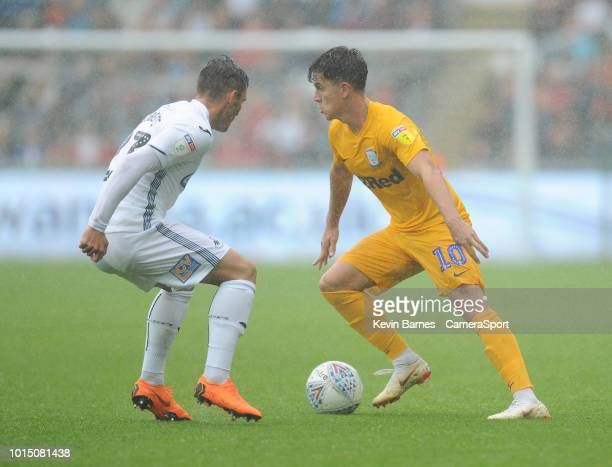 Preston North End's Josh Harrop under pressure from Swansea City's Connor Roberts during the Sky Bet Championship match between Swansea City and...