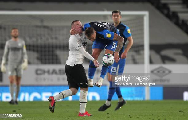 Preston North End's Patrick Bauer battles with Derby County's Wayne Rooney during the Carabao Cup Second Round Northern Section match between Derby...