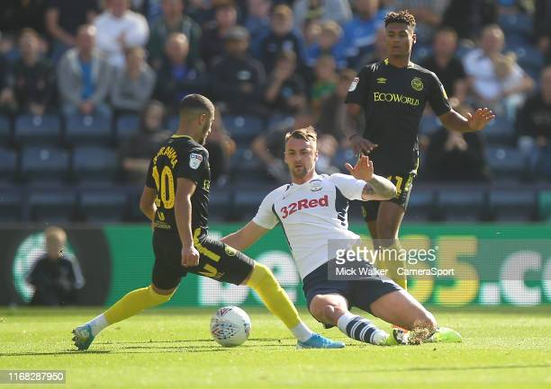 Preston North End's Patrick Bauer in action with Brentford's Said Benrahma during the Sky Bet Championship match between Preston North End and...