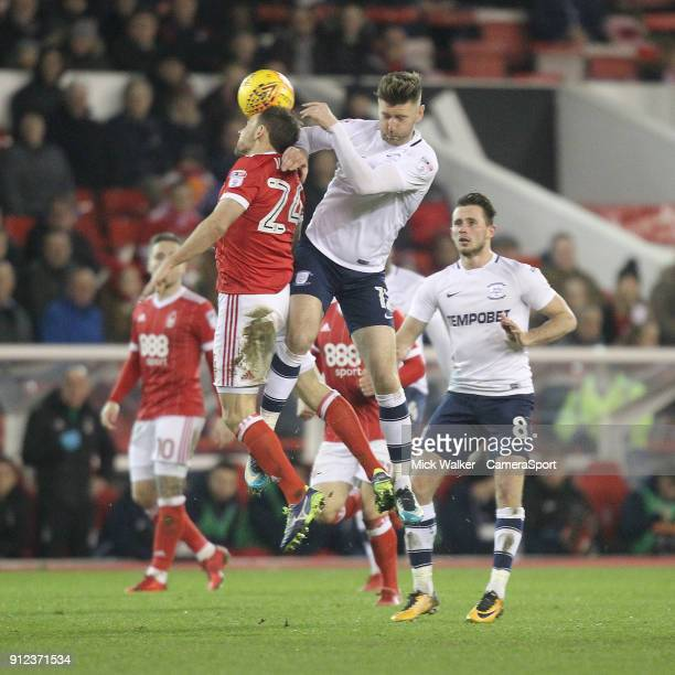 Preston North End's Paul Gallagher jumps with Nottingham Forest's David Vaughan during the Sky Bet Championship match between Nottingham Forest and...