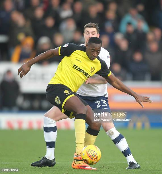 Preston North End's Paul Huntington battles with Burton Albion's Lucas Atkins during the Sky Bet Championship match between Burton Albion and Preston...