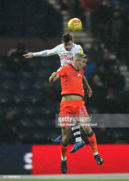 Preston North End's Paul Huntington jumps with Millwall's Steve Morison during the Sky Bet Championship match between Preston North End and Millwall...