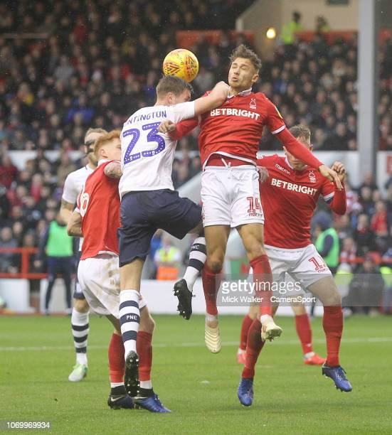 Preston North End's Paul Huntington jumps with Nottingham Forest's Matty Cash during the Sky Bet Championship match between Nottingham Forest and...