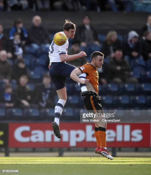 Preston North End's Paul Huntington jumps with Wolverhampton Wanderers Ivan Cavaleiro during the Sky Bet Championship match between Preston North End...