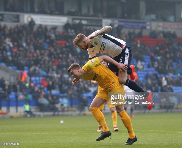 Preston North End's Paul Huntington tangles with Bolton Wanderers' Mark Beevers during the Sky Bet Championship match between Bolton Wanderers and...
