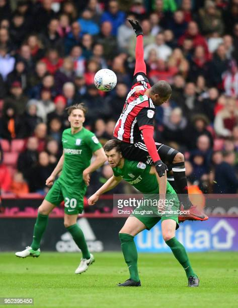 Preston North End's Paul Huntington vies for possession with Sheffield United's Leon Clarke during the Sky Bet Championship match between Sheffield...