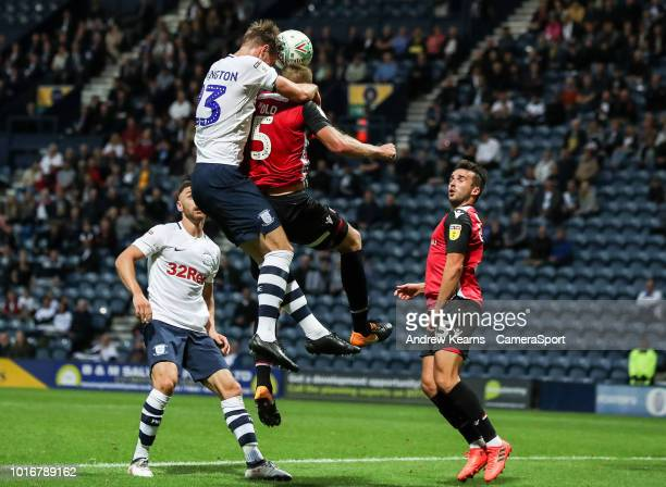 Preston North End's Paul Huntington wins an aerial battle during the Carabao Cup First Round match between Preston North End and Morecambe at...