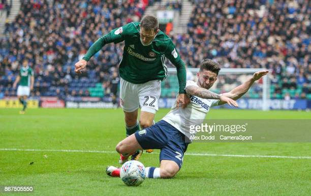 Preston North End's Sean Maguire battles with Brentford's Henrik Dalsgaard during the Sky Bet Championship match between Preston North End and...