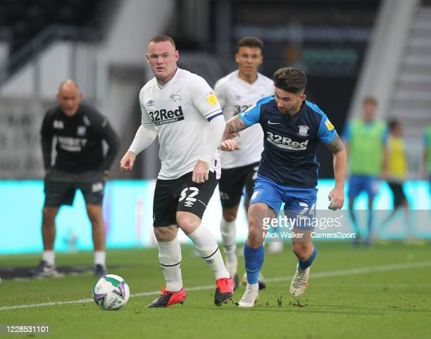 Preston North End's Sean Maguire battles with Derby County's Wayne Rooney during the Carabao Cup Second Round Northern Section match between Derby...