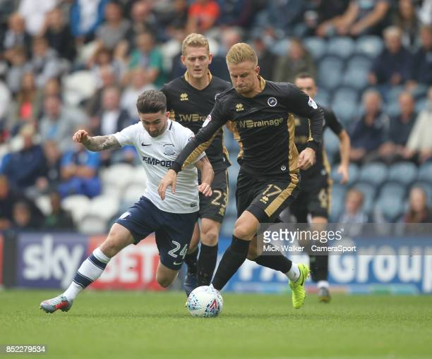 Preston North End's Sean Maguire battles with Millwall's Byron Webster during the Sky Bet Championship match between Preston North End and Millwall...