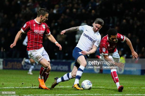 Preston North End's Sean Maguire beats Bristol City's Joe Bryan and Korey Smith before slotting the winning goal during the Sky Bet Championship...